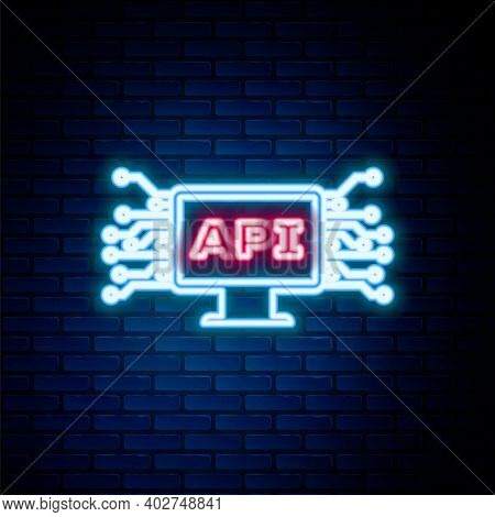 Glowing Neon Line Computer Api Interface Icon Isolated On Brick Wall Background. Application Program