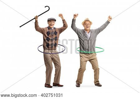 Full length portrait of two elderly men spinning hula hoops and gesturing happiness isolated on white background