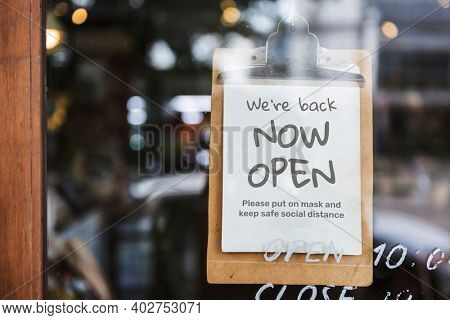 We're back, now open cafe sign after covid-19 pandemic