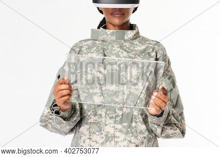 Female military using transparent tablet mockup with VR headset