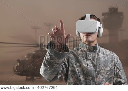 Military in VR headset touching virtual screen for simulation training military technology