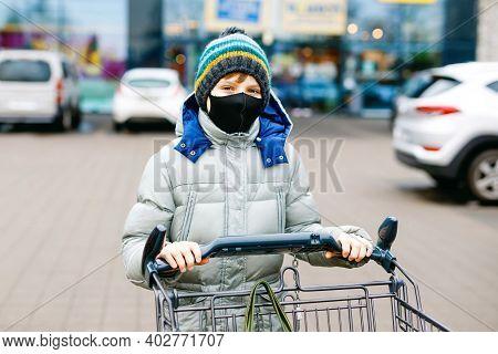 Kid Boy Wear Medical Mask As Protection Against Pandemic Coronavirus Disease. Child Use Protective E
