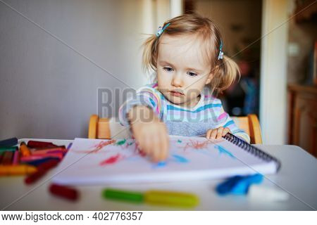 Adorable Little Girl Painting With Color Pencils At Home, In Kindergaten Or Preschool. Creative Game