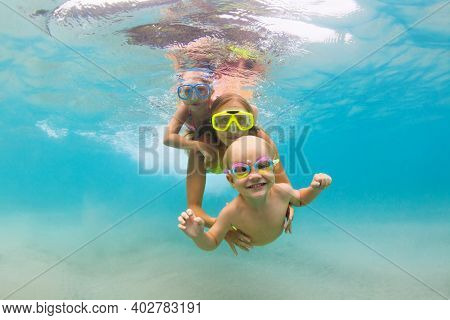Young Mother, Baby Boy, Girl Jump, Dive Underwater With Fun In Tropical Lagoon Pool. Travel Lifestyl