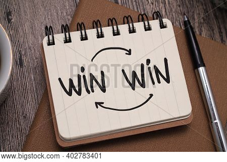 Win Win, Text Words Typography Written On Paper Against Wooden Background, Life And Business Motivat