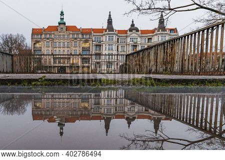 Wroclaw January 9 2020 Old Tenement Castle Building Reflected In Small Puddle