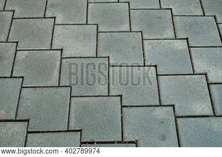Concrete Or Cobble Gray Square Pavement Slabs Or Stones For Floor, Wall Or Path. Road Paving