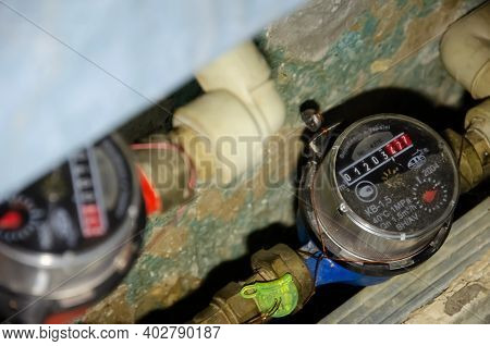 Lutsk, Ukraine - January 11 2021. Water Meters In Niche In The Apartment. Close-up Dirty Old Cold Wa