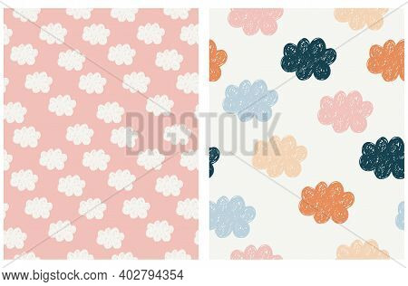 Lovely Seamless Vector Pattern With Hand Drawn Clouds Isolated On A Pastel Pink And Light Beige Back