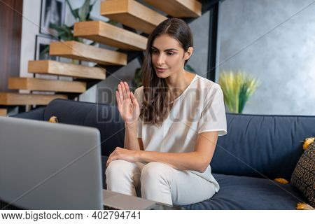 Woman Having Online Therapy Session With Her Therapist