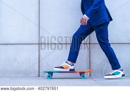 Close Up Of Businessman Skating Outdoors.