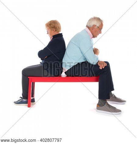 elderly couple having quarrel isolated over white background