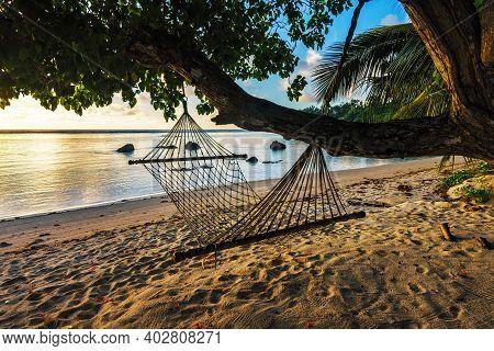Hammock At Beautiful Sunrise On Paradise Beach, Seychelles