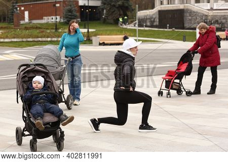 Moscow, Russia, October 30, 2020: Unidentified Women With Kids On Pram Fitness Lesson With Instructo