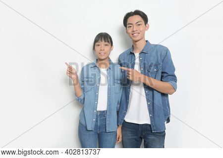 Relationship concept.young couple back to back posing on a white background.