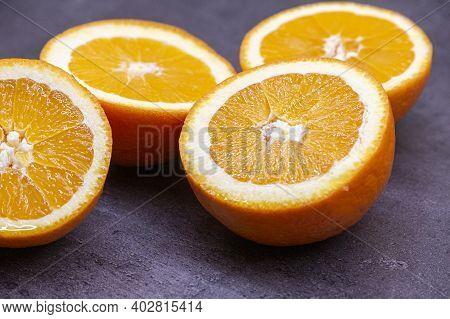 Sliced Fresh Oranges On A Dark Background. Juicy Fruit