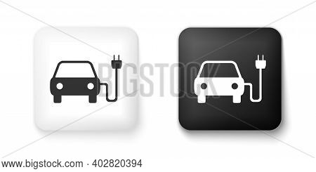 Black And White Electric Car And Electrical Cable Plug Charging Icon Isolated On White Background. E