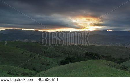Rolling Hills And Ominous Sky Sunset Via Coyote Peak. Santa Teresa County Park, Santa Clara County,