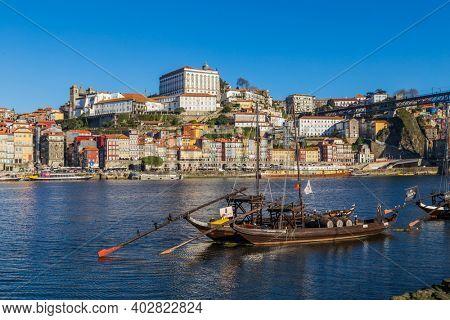 Porto, Portugal - December 26, 2020: Boats with porto wine in Porto, Portugal. Douro River