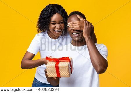 Cheerful African American Young Woman Making Valentine Surptise For Her Happy Husband, Covering His