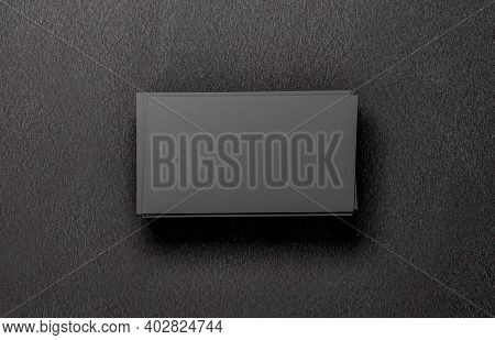 Stack Of Business Card Mockup. Closeup On Two Empty Business Cards Stack On A Black Background, 3d R