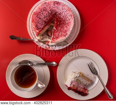 Diet Low-calorie Raspberry Sponge Cake With Jelly, Whipped Cream And Fresh Berries, A Cup Of Tea On