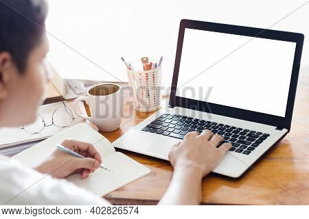 Mockup Copy Space Computer Notebook Laptop Concept, A Man's Hand Using A Laptop On Internet Websites