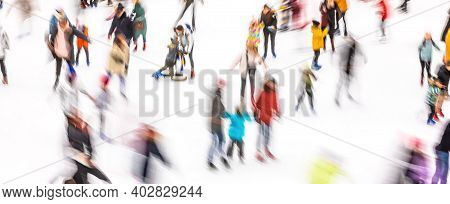 Motion Blurred Image Of People Skating On An Ice Rink