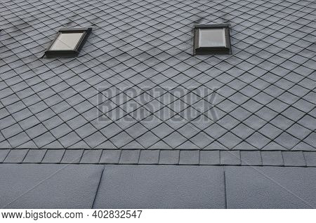 Gray Roof Tiles With Windows Square Slate Template. Laid Obliquely. Square Grid Pattern. The Lower E