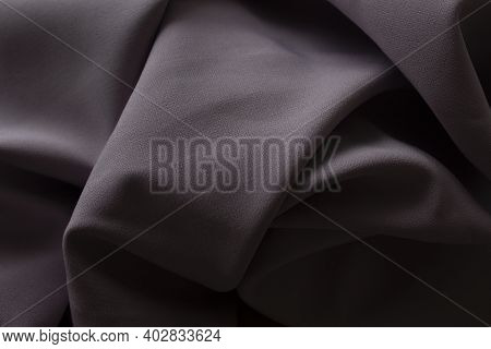 Close-up Texture Of Purple Fabric Or Cloth In Purple Color. Fabric Texture Of Purple Background. Cru