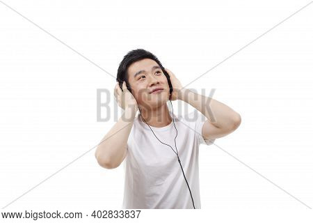 A Young Man In Vitality With Earphone High Quality Photo