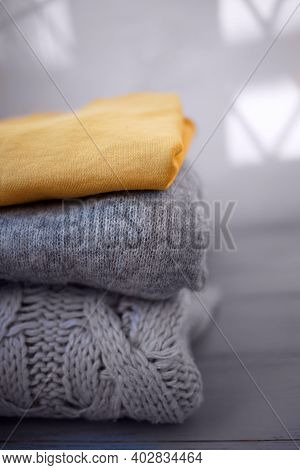 Cozy Sweaters In Ultimate Gray And Illuminating On A Grey Background