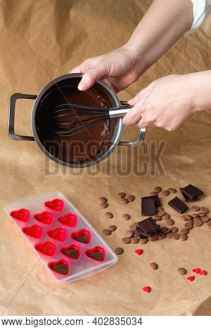 Handmade Valentines Day Dessert. Making Chocolate Candy, Female Hands Filling Heart Shaped Mold. Cho