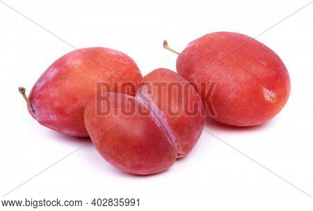 Bizarre double plum, mutant fruit in heart-shape isolated over white background
