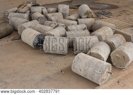 Concrete Cores Close-up. The Result Of The Concrete Core Drilling Process. Drilling In Concrete. Ind