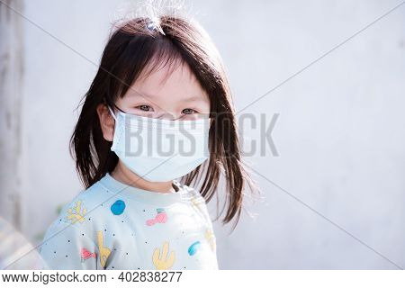 Candid Children Wear Medical Face Mask To Prevent The Spread Of The Coronavirus Disease (covid-19).