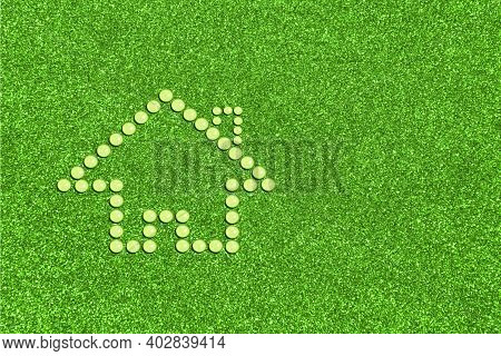 Eco Friendly House Concept. Figure Of House Made Of Water Drops. Icon On Green Grass Background With