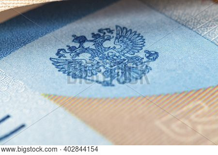 Coat Of Arms Of Russia On The Banknote Of The Russian Federation With A Face Value Of 2000 Rubles. M