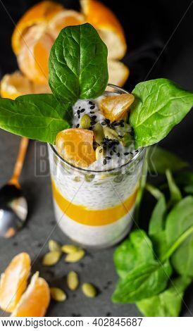 Mandarin, Spinach And Banana Chia Pudding With Almond Milk