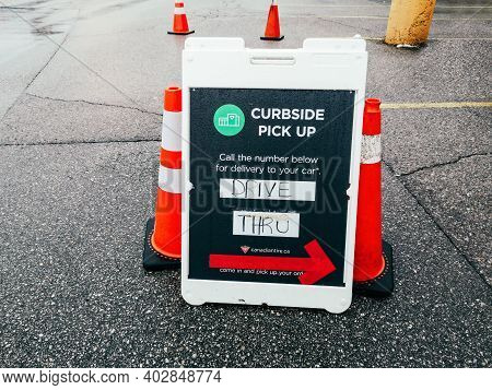 Toronto, Ontario, Canada - January 3, 2021: Street Sign Saying Contactless Curbside Pickup Available