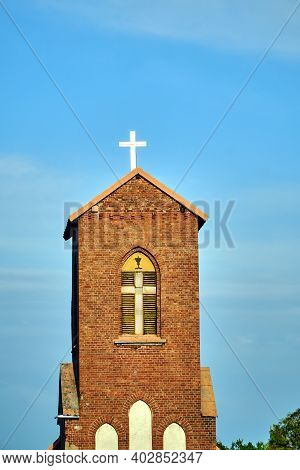 Medieval Brick Belfry Of Roman Catholic Church In Gothic Style In Poland