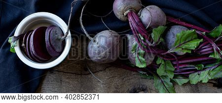 Bunch Of Beetroots On Old Wood Background. Top View. Freshly Picked Vegetables Beetroot