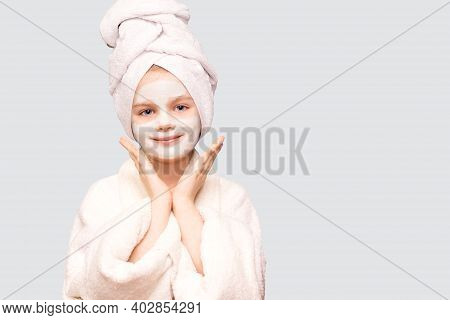 Pleased Child Girl With Wrapped Towel On Head Delighted Expression Isolated On White Background, App