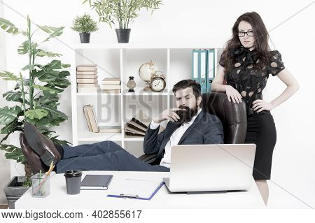 Typical Office Life. Man Bearded Hipster Boss Sit In Leather Armchair Office Interior. Boss And Secr