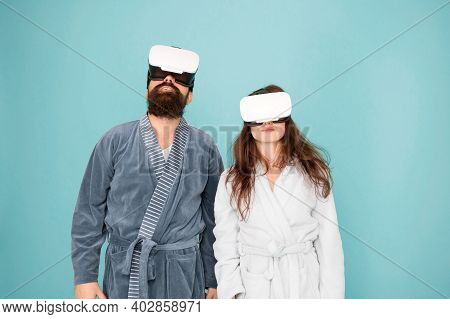 Awakening From Virtual Reality. Couple In Bathrobes Wear Vr Glasses. Conscious Awakening. Return To
