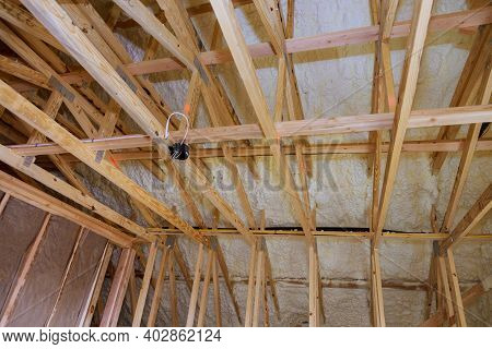 House In Unfinished Under Construction In Insulation Foam The Wall Roofing Of A Attic