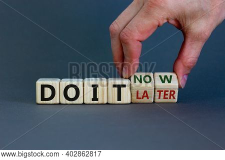 Do It Now Symbol. Businessman Hand Turns Cubes And Changes Words 'do It Later' To 'do It Now'. Beaut