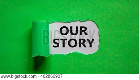 Our Story Symbol. Words 'our Story' Appearing Behind Torn Green Paper. Business And Our Story Concep