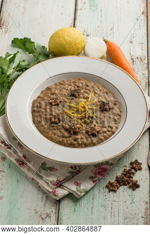Lentils soup with lemon peel and parsley