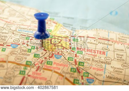 A Blue Pin Pressed Into A Map Detailing The Point Of Interest Referring To The Place Named Rochester